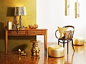 Lamps, cushions, shoes and miniature table - home accessories in shimmering gold