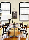 Set dining table and chairs in loft-style interior