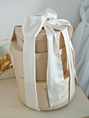 Three round gift boxes tied together with chiffon ribbon