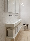 Long washstand with storage baskets and mirrored wall cabinets in white, minimalist bathroom