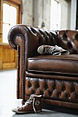 Heavy leather couch with quilted backrest