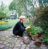 A woman in a garden, Sweden.
