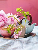 A teapot and flowers.
