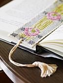 A bookmark in a book, close-up.
