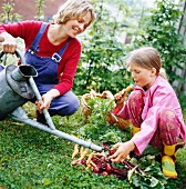 Mother and daughter with vegetables, Sweden.