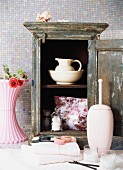 Old cupboard with crockery and toiletries