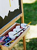 Paint cups on easel