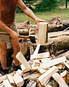 A man chopping wood.