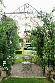 Idyllic gazebo with nostalgic trellising and roses surrounding central seating area