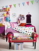 Colourful child's bedroom with bed, shelves and stool