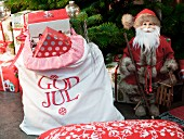 Father Christmas figurine & sack of presents under Christmas tree