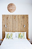 Double bed with headboard made from bamboo poles
