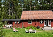 Woman in lounger outside holiday cottage (Södermanland, Sweden)