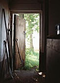 Gardening equipment in barn with open wooden door
