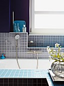 Mosaic-tiled bathroom in various shades of blue
