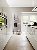 Bright, modern kitchen with grey walls and white units