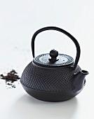 Oriental cast iron teapot
