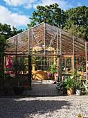 Glazed greenhouse in garden