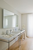 Elegant, purist, white designer bathroom with pale parquet floor