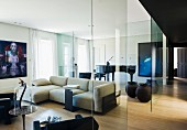 Designer apartment with glass partitions, artworks and concert grand piano in background