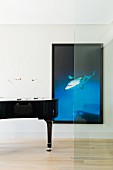 Black concert piano and photographic artwork with black frame