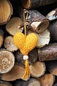 Yellow, hand-knitted yarn heart