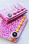 Elastic ribbons decorated with buttons on notebooks