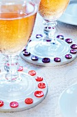 Drinks coasters decorated with buttons