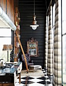 Steampunk loft apartment with reading corner next to bookcase
