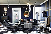Dark blue and black seating area with leather loungers in front of flat screen TV, Chesterfield sofa and antique barber's chair