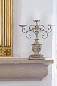 Three-armed candlestick on ledge