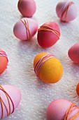 Dyed Easter eggs wrapped with yarn