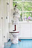Tailors' dummy and laundry bin with hand-sewn covers of Toile de Jouy fabric