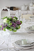 Spring bouquet on table set in white