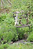Angel figurine on willow wreath on weathered garden chair