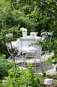 Table set in white in garden