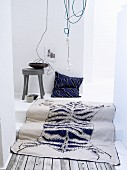Blue and white rug with animal-skin motif and blue cushion