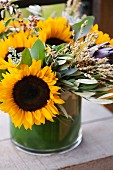 A Floral Arrangement with Sunflowers and Eucalyptus