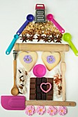 Baking utensils, biscuits and elements in the shape of a house