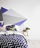 Bed with headboard painted on wall