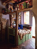 Comfortable reading area with built-in bookcase next to window in renovated, Mediterranean country house