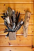 Various local bird feathers are used as decor in an Adirondacks cabin