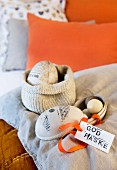 Easter eggs and Easter greeting on bed
