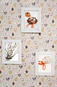 Framed Easter pictures on wallpaper with pattern of hens