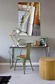 Small desk, vintage chair and artistic photo on wall