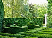 Garden with wellpmanicured hedges and topiaries