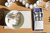 Laid table with cutlery pocket and name tag