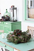 Rustic winter arrangement on old green furniture outside outside house