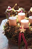 Rustic Advent wreath with four candles in wicker basket