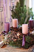 Rustic Advent wreath with pink and lilac candles